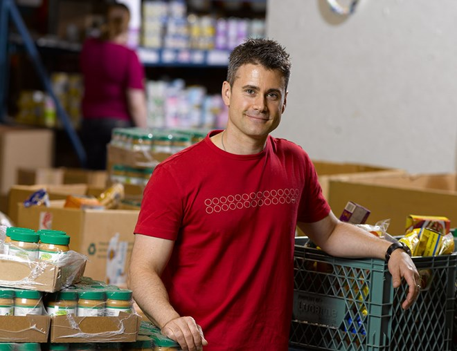 Volunteer helping at a food bank
