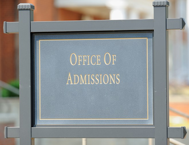 """Office of Admissions"" sign"