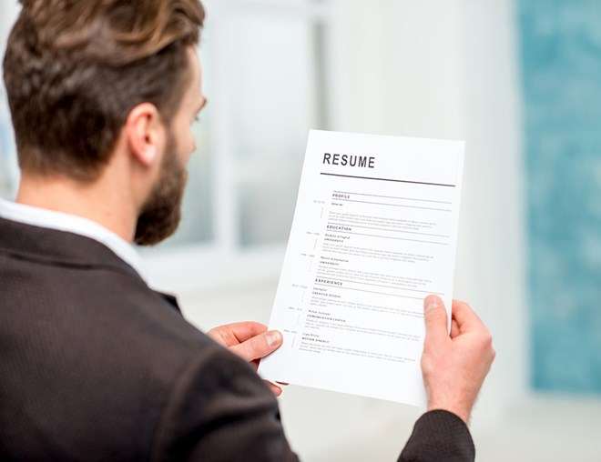 Person looking at a resumé