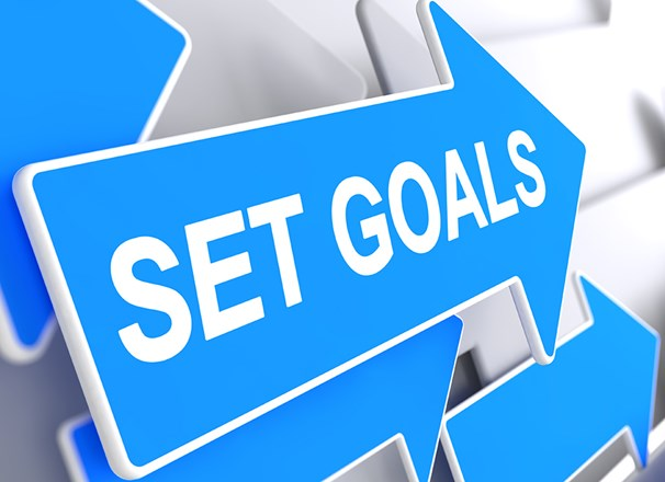 "Graphic of blue arrows with ""Set Goals"" printed"