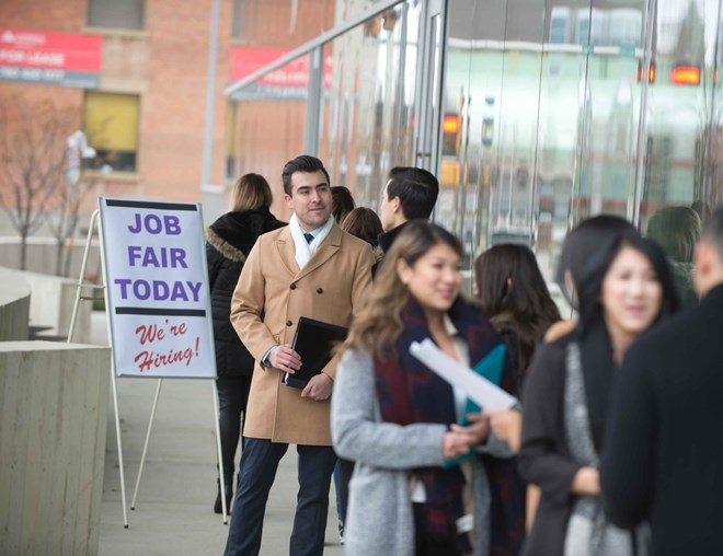 Job seekers standing in line at a job fair
