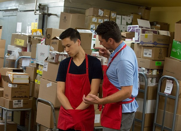 Employer bullying an employee in the storeroom