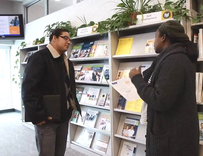 Job seeker discussing with career counsellor at an Alberta Supports Centre