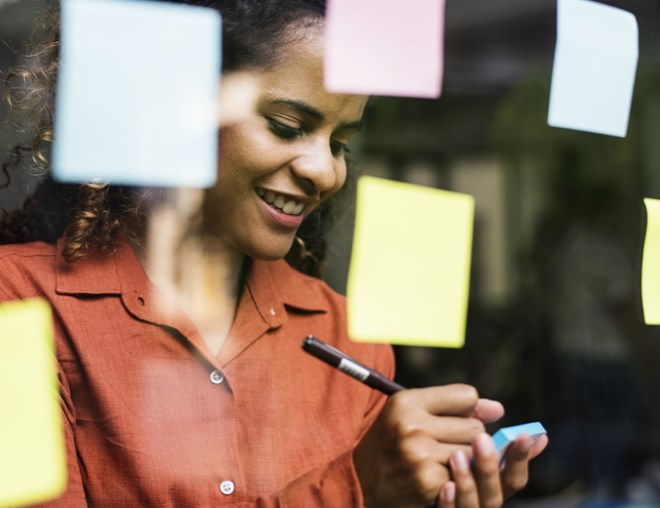 Person brainstorming with sticky notes
