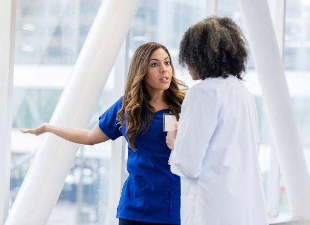 Two female health care workers having a disagreement.
